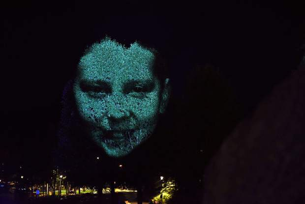 """The face of 12-year-old local dancer Zoe Gallup is projected on a tree in downtown Breckenridge as contemporary Australian artist Craig Walsh tests out a new public art installation titled """"Monuments"""" ahead of the Breckenridge International Festival of Arts, which runs today through Aug. 20."""