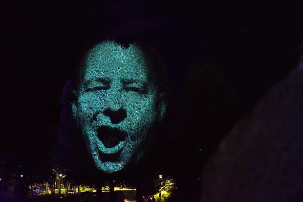 """The face of local biking enthusiast Jeff Westcott is projected on a tree in downtown Breckenridge as contemporary Australian artist Craig Walsh tests out a new public art instillation titled """"Monuments"""" ahead of the Breckenridge International Festival of Arts, which runs today through Aug. 20."""