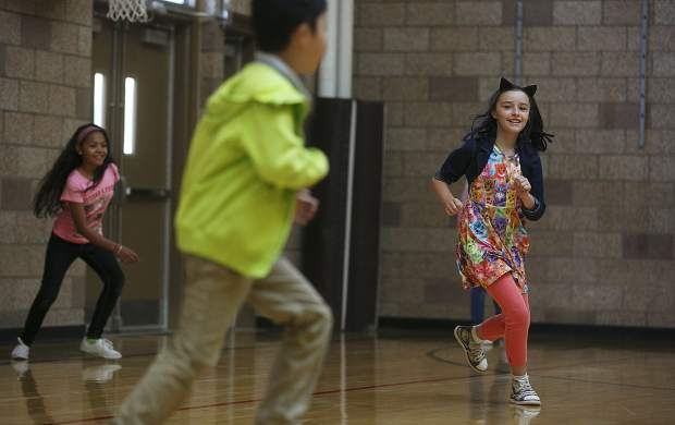 Kyah Quam participates in a game of tag with other students during morning gym class in Silverthorne.