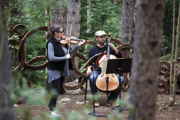 Kate Hatmaker, with violin, and Alex Greenbaum, with cello, perform along side of Illinois Creek Trail in part of Breckenridge International Art Festival's Trail Mix series Monday, Aug. 14, in Breckenridge.