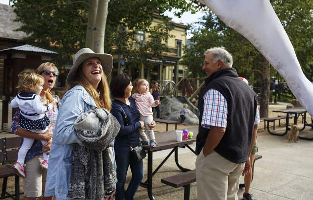 Passerbys react as they watch the Birdmen, large pterodactyl-like creatures created by Close Act Theatre, roam in the Blue River Plaza in part of the Breckenridge International Festival of the Arts Wednesday, Aug. 16.