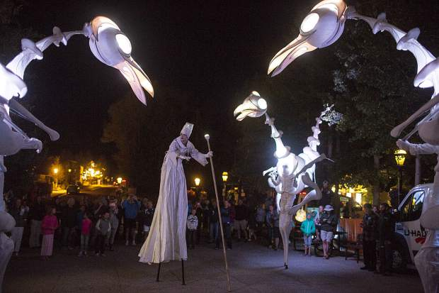 The Birdmen, large pterodactyl-like creatures created by Close Act Theatre, roam in the Blue River Plaza in part of the Breckenridge International Festival of the Arts Wednesday, Aug. 16.