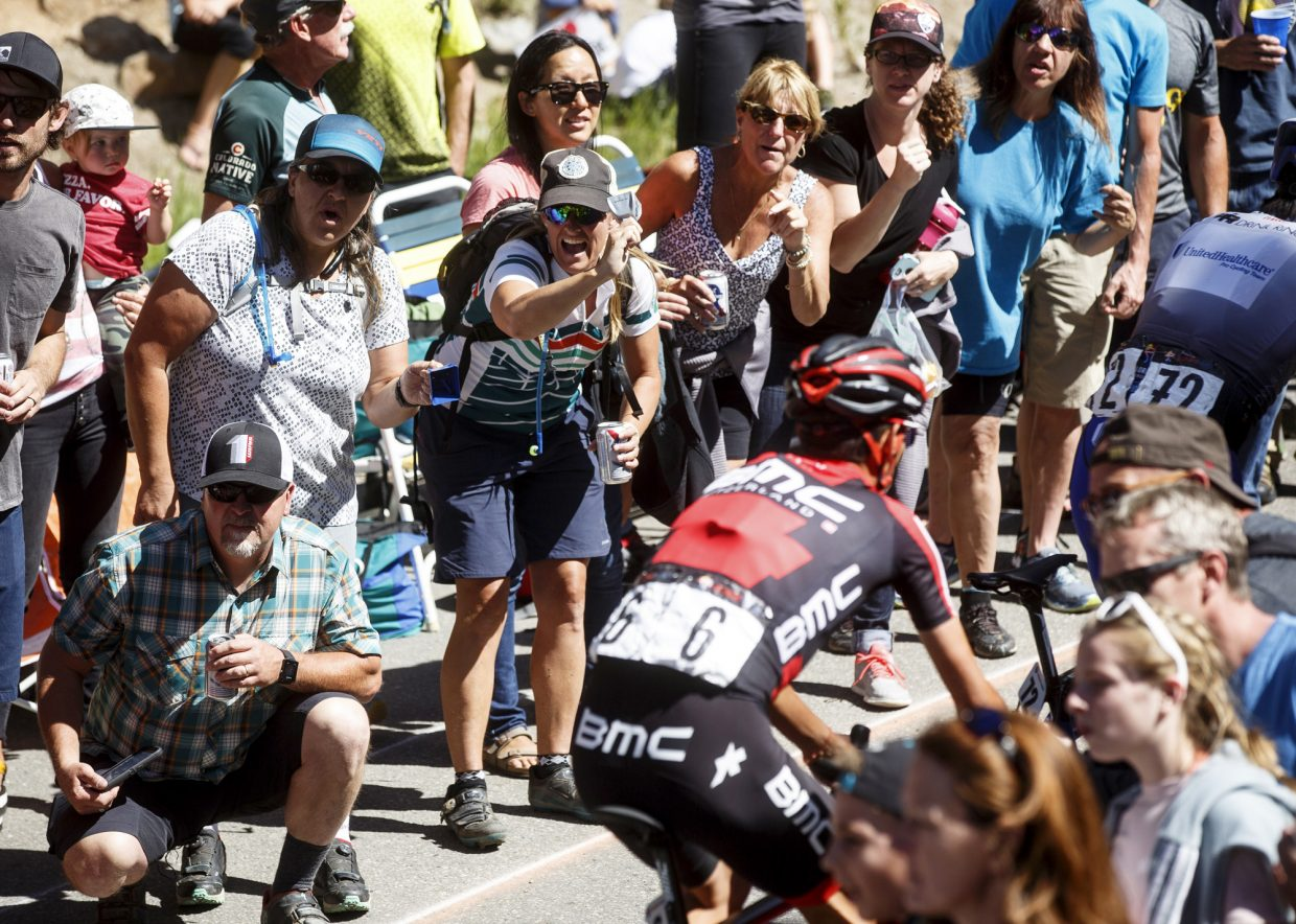 Spectators cheer on cyclist TJ Eisenhart during the Colorado Classic's Stage 2 race on Boreas Pass Road Friday, Aug. 11 in Breckenridge.