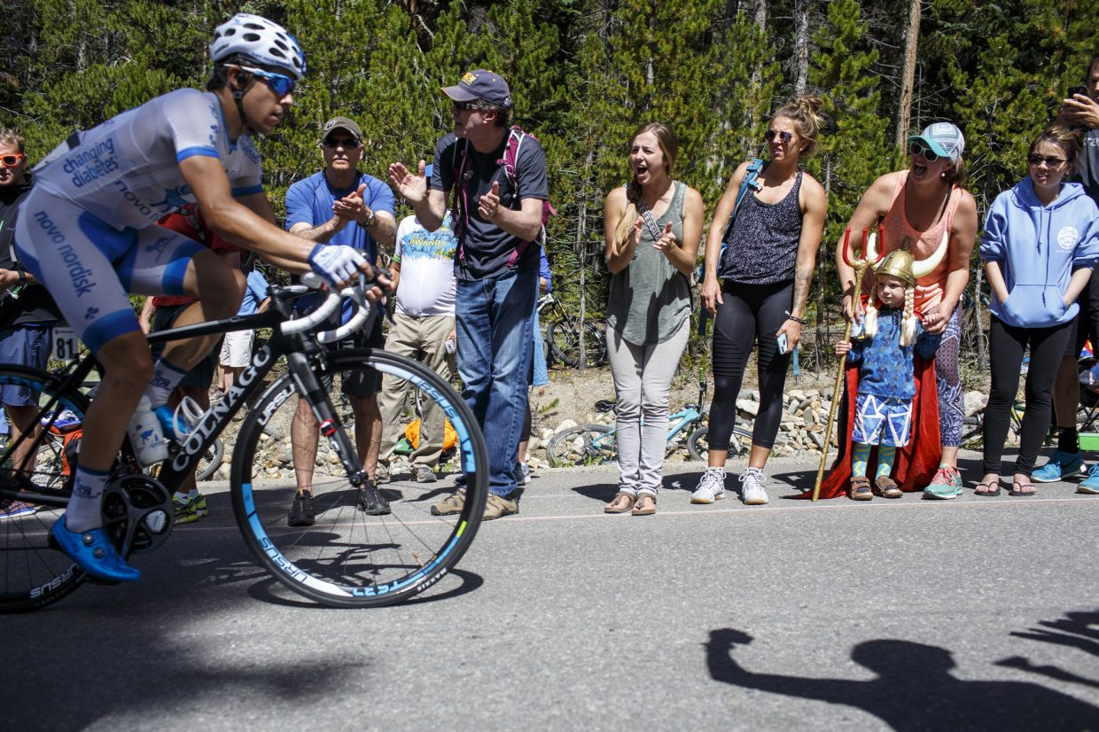 Spectators cheer on road cyclists competingng in the Colorado Classic's Stage 2 race on Boreas Pass Road Friday, Aug. 11 in Breckenridge.