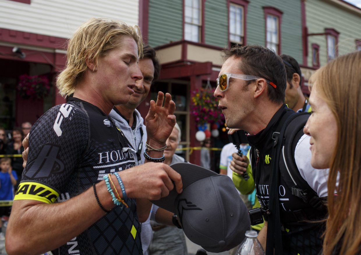 TJ Eisenhart, right, catches his breath as his colleagues give support following the Colorado Classic's Stage 2 race on Boreas Pass Road Friday, Aug. 11 in Breckenridge. Eisenhart place second in the stage but still leading the overall race.