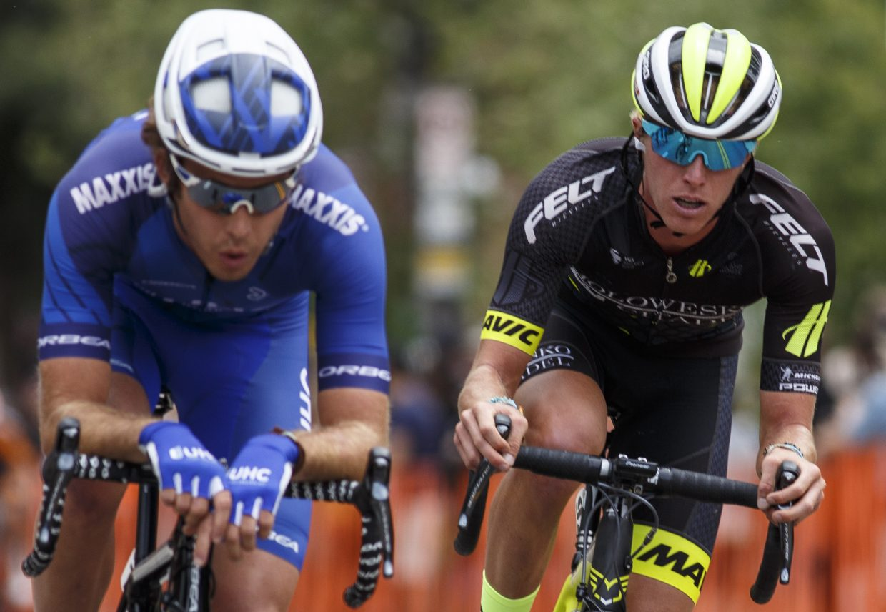 TJ Eisenhart, right, continues to lead rounds throughout the Colorado Classic's Stage 2 race on Boreas Pass Road Friday, Aug. 11 in Breckenridge.