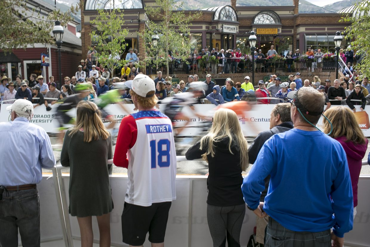 Spectators cheer on cyclists competing in the Colorado Classic's Stage 2 race on Main Street Friday, Aug. 11 in Breckenridge.