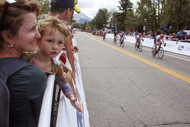 Donna Sundstrom, left, and her daughter Asa, 5, cheer on the competitors in the Colorado Classic's Stage 2 race through Breckenridge's Main Street Friday, Aug. 11.