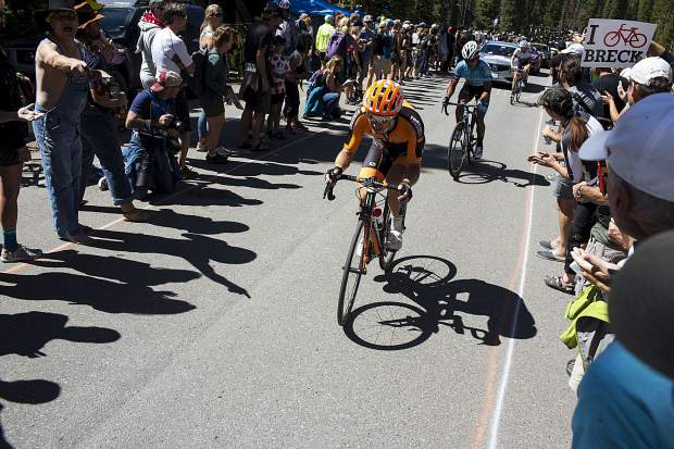 Spectators cheer on cyclists during the Colorado Classic's Stage 2 race on Boreas Pass Road Friday, Aug. 11 in Breckenridge.