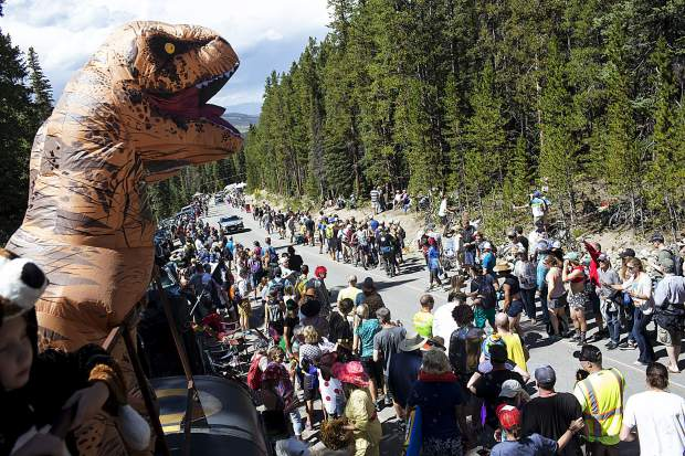 Spectators cheer on road cyclists competing in the Colorado Classic's Stage 2 race on Boreas Pass Road Friday, Aug. 11 in Breckenridge.