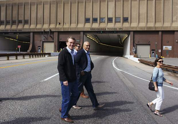 Sen. Michael Bennet, left, keeps eye on westbound I-70 traffic at a safe distance in front of the Eisenhower Tunnel with CDOT Executive Director Shailen Bhatt Wednesday, Aug. 23, on Loveland Pass.