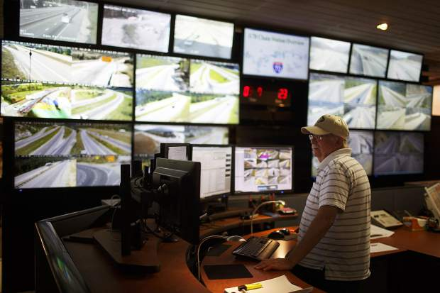 Eisenhower Tunnel operator and dispatcher David Griffith keep eyes on the monitors of passing traffic inside the control room Wednesday, Aug. 23, on Loveland Pass.