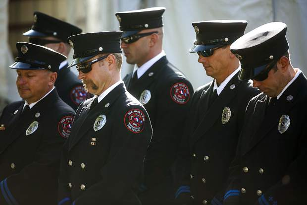 Members of the Red, White, and Blue Fire Protection District have a moment of silence during a community remembrance ceremony at the Blue River Plaza Monday, Sept. 11, in Breckenridge.