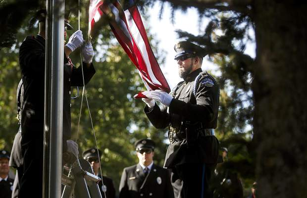 Sgt. Bryan Ridge of Breckenridge Police Department, right, raises the American flag with the members of the Red, White, and Blue Fire Protection District during a community remembrance ceremony at the Blue River Plaza Monday, Sept. 11, in Breckenridge.
