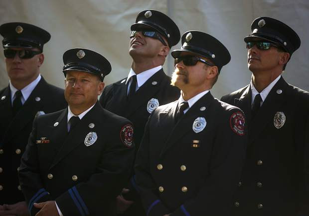 Members of the Red, White, and Blue Fire Protection District look up towards the American flag pole during the community remembrance ceremony at the Blue River Plaza Monday, Sept. 11, in Breckenridge.