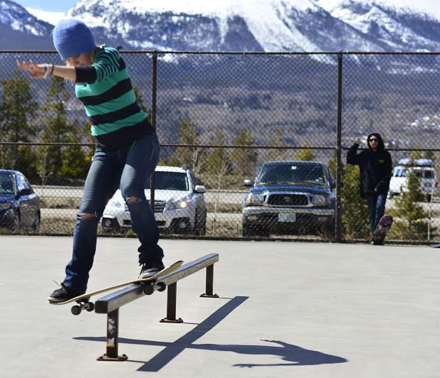 Taylor Carnell grinds a rail Wednesday at the skate park in Frisco while her husband, Ryan, a skateboard coach at the Woodward Copper indoor skate park, looks on. The couple said that of all the parks in Summit County, Frisco's is their favorite.