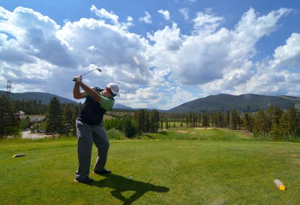 Keystone assistant golf pro Denny Weber tees off on Hole 9 of The River Course. The club is home to two full 18s: The River Course, opened in 2000, and Keystone Ranch Course, opened in the '80s.