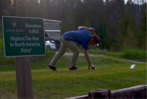 A golfer tees up on Hole 16 at Copper Creek Golf Course, considered the