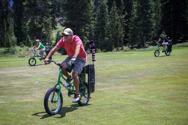 Golfers ride special-made golf bikes at Copper Creek Golf Course. The golf bikes are back this year for a second season when 18 holes open on June 9.