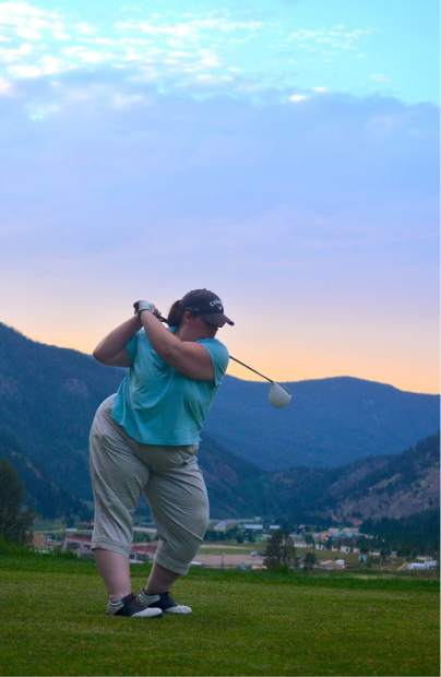 Summit local Susan Gilmore tees off on Hole 16 at Copper Creek Golf Course, considered