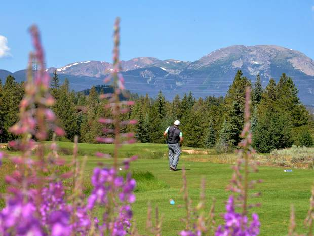 Keystone assistant golf pro Denny Weber watches his shot on Hole 7 at The River Course, with views of Buffalo Mountain in the distance. It's the signature hole on The River Course, one of two full 18s just east of the ski slopes. The club opens for the 2017 season on May 12 with 18 holes on The River Course.