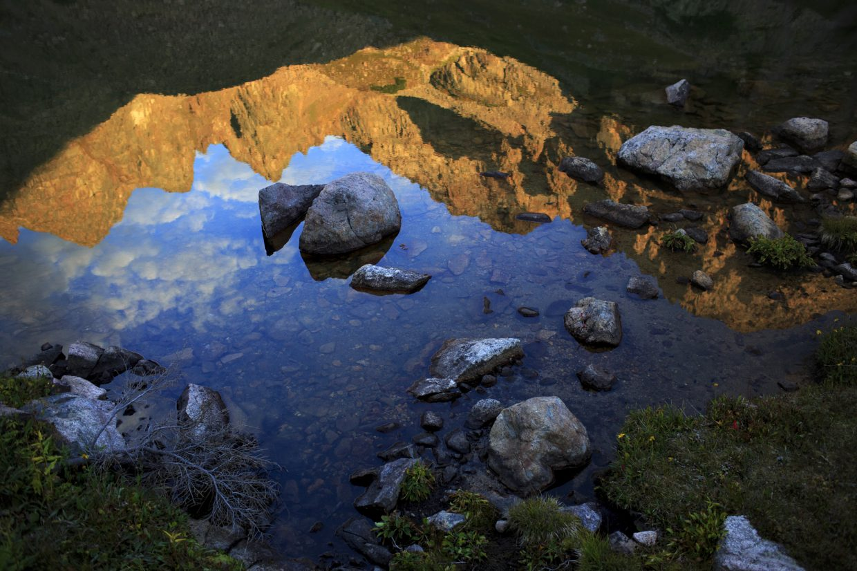 Upper Willow Lake's reflection of the spires of the Gore Range.