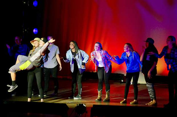 Summit High School girls rugby team puts on Air Band performance.