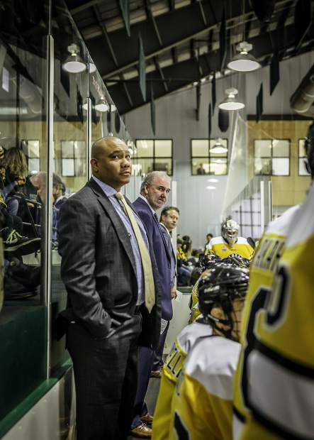 Colorado College's coachig staff watches the game intently.
