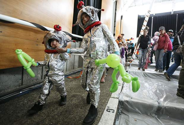 Arlo Murrel, 2, left, and his brother Jonah, 7, walk in the parade during the Fall Festival at the Riverwalk Center Saturday, Oct. 14, in Breckenridge.