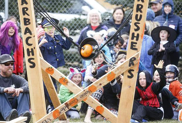 Frisco Elementary School students and teachers launch a pumpkin with a catapult Friday, Oct. 27, in Frisco.