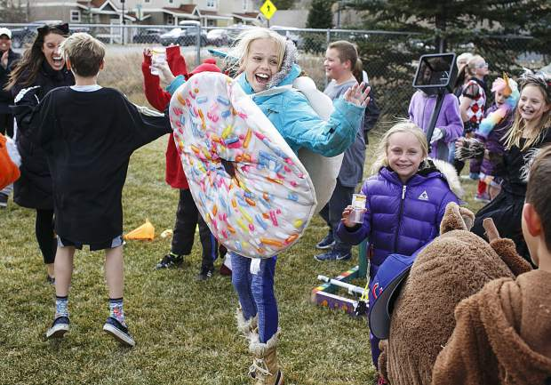 Frisco Elementary School students celebrate aftering launching a pumpkin with a catapult Friday, Oct. 27, in Frisco.