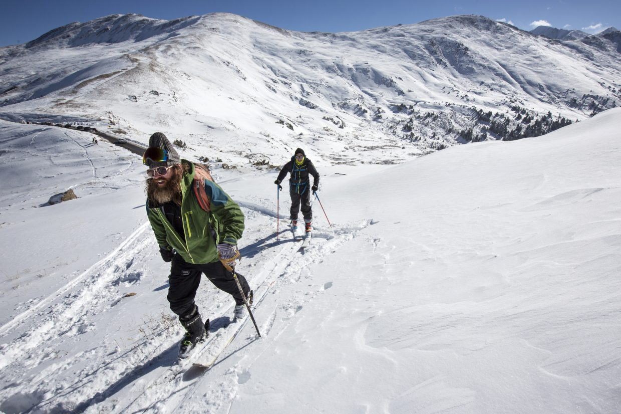 Aspen residents Dave Holten, front, and Andrew Benaquista skin their way up at Loveland Pass Tuesday, Oct. 3.