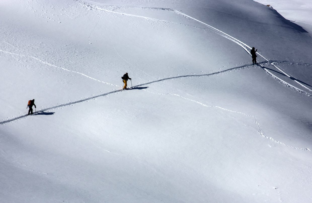 Skiers hike their way up Tuesday, Oct. 3, at Loveland Pass.