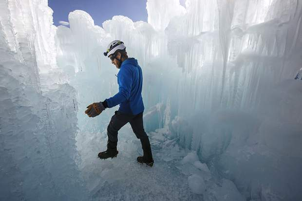 Dan Beck, Ice Castles' site manager, navigates his way around the site Wednesday, Dec. 20, in Dillon Town Park.