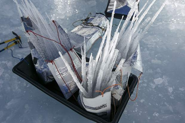 Icicles put in bags for construction of the Ice Castles Wednesday, Dec. 20, in Dillon Town Park.