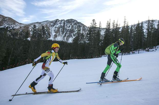 Ski mountaineering competitors skin uphill during the