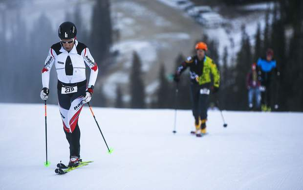 Ski mountaineering competitors skin their way uphill during the