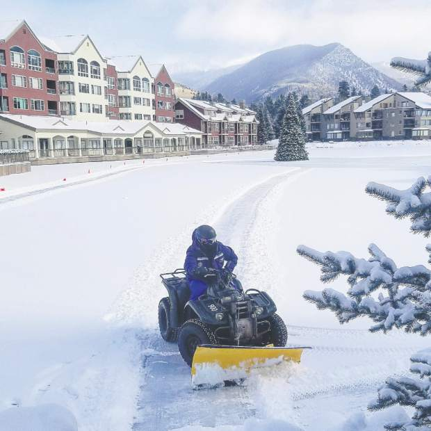 Snow is cleared at Keystone Resort's Lakeside Village Thursday morning.