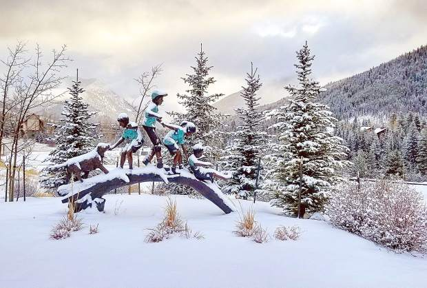 Freshly-fallen snow clings to statues at Keystone Resort Thursday morning after four inches fell since late Wednesday night.