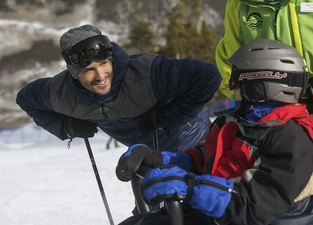 Jeremy Bloom, U.S. Olympian and former University of Colorado football player, interacts with Eleanor