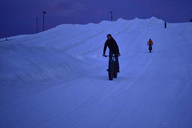 Followed by Scott Pohlman and Ruth Meade, Eric Bensen leads the way coming down a hill at Frisco Adventure Park while testing out some fat bikes Tuesday.