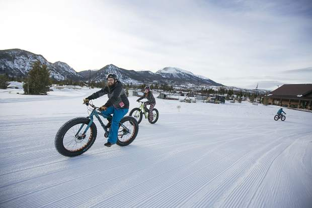 RJ McHenry, front, and Jamie Pestien test a fat tire bikes during a demo day made possible by Breck Bike Guide at the Frisco Adventure Park Tuesday, Jan. 30, in Frisco. The demo day and wrap party in Frisco capped a weekend of events at the annual winter Outdoor Retailer show, which was hosted late last week at the Denver Convention Center.