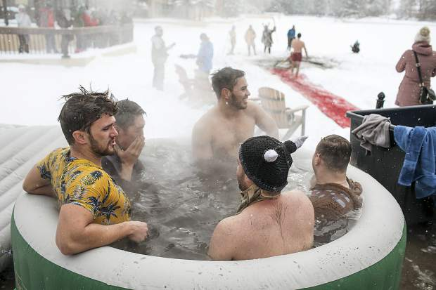 Participants soak in the hot tub following a dip in the Maggie Pond for the Ullr Ice Plunge Friday, Jan. 12, in Breckenridge.