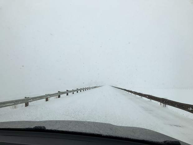 Dam Road during snow storm on Sunday morning.