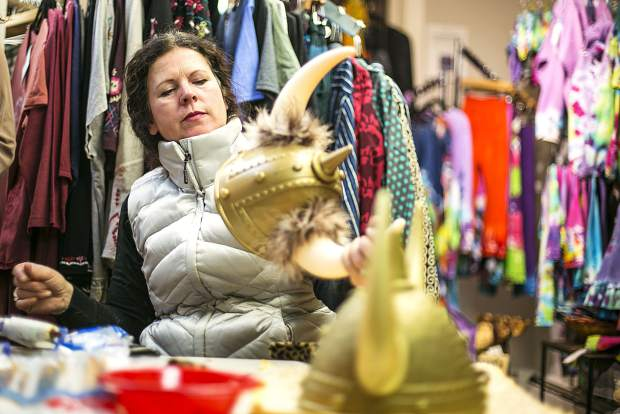 Heather Wickstrom, owner of Get Real Bazaar, decorates an ullr helmet at her store Monday, Jan. 8, along Main Street in Breckenridge. The Ullr Helmet Decorating event is available to public from 6 p.m. to 8 p.m. today at Get Real Bazaar in spirit of Ullr Fest occurring on Thursday.
