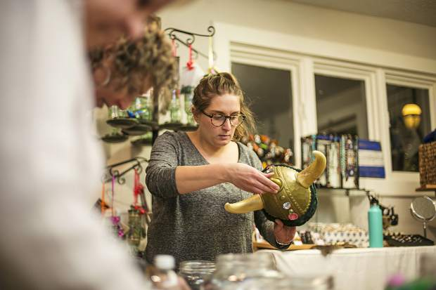 Julia Elrath decorates an ullr helmet Monday, Jan. 8, at the Get Real Bazaar along Main Street in Breckenridge. The Ullr Helmet Decorating event is available to public from 6 p.m. to 8 p.m. today at Get Real Bazaar in spirit of Ullr Fest occurring on Thursday.