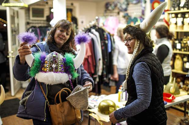 Wendy Clairmont, left, and Sheri Paul check out an ullr helmet Monday, Jan. 8, at the Get Real Bazaar along Main Street in Breckenridge. The Ullr Helmet Decorating event is available to public from 6 p.m. to 8 p.m. today at Get Real Bazaar in spirit of Ullr Fest occurring on Thursday.