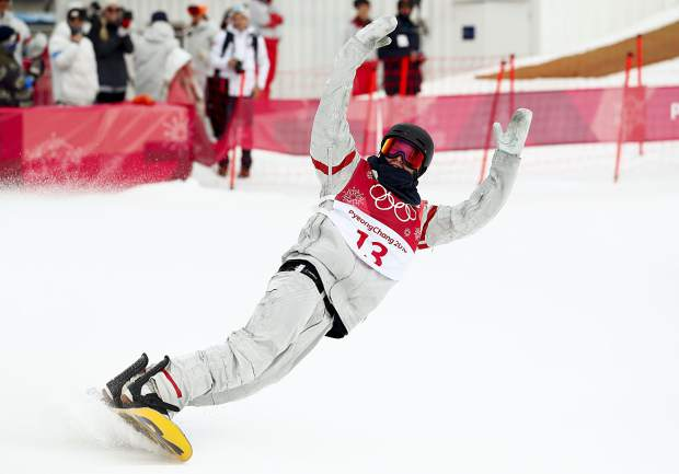 Kyle Mack, of the United States, reacts after his jump during the men's Big Air snowboard competition at the 2018 Winter Olympics in Pyeongchang, South Korea, Saturday, Feb. 24, 2018. (AP Photo/Matthias Schrader)