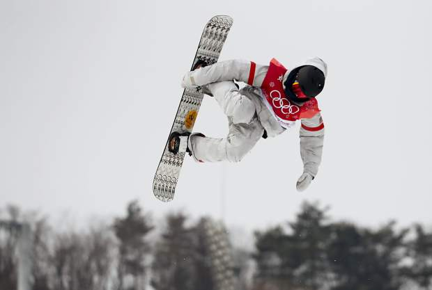 Kyle Mack, of the United States, jumps during the men's Big Air snowboard competition at the 2018 Winter Olympics in Pyeongchang, South Korea, Saturday, Feb. 24, 2018.