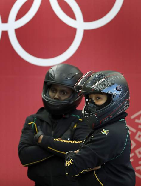 Driver Jazmine Fenlator-Victorian, right, and Carie Russel, left, of Jamaica prepare for a women's bobsled training run at the 2018 Winter Olympics in Pyeongchang, South Korea on Saturday, Feb. 17.